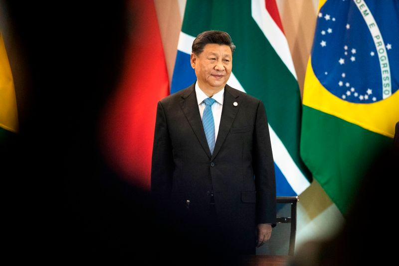 China's President Xi Jinping arrives at a meeting during a BRICS Summit.