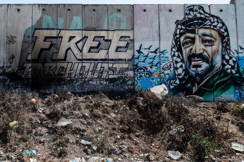 A mural on Israel's controversial separation wall between Jerusalem and Ramallah depicts the former chairman of the Palestine Liberation Organization, Yasser Arafat, in 2017.