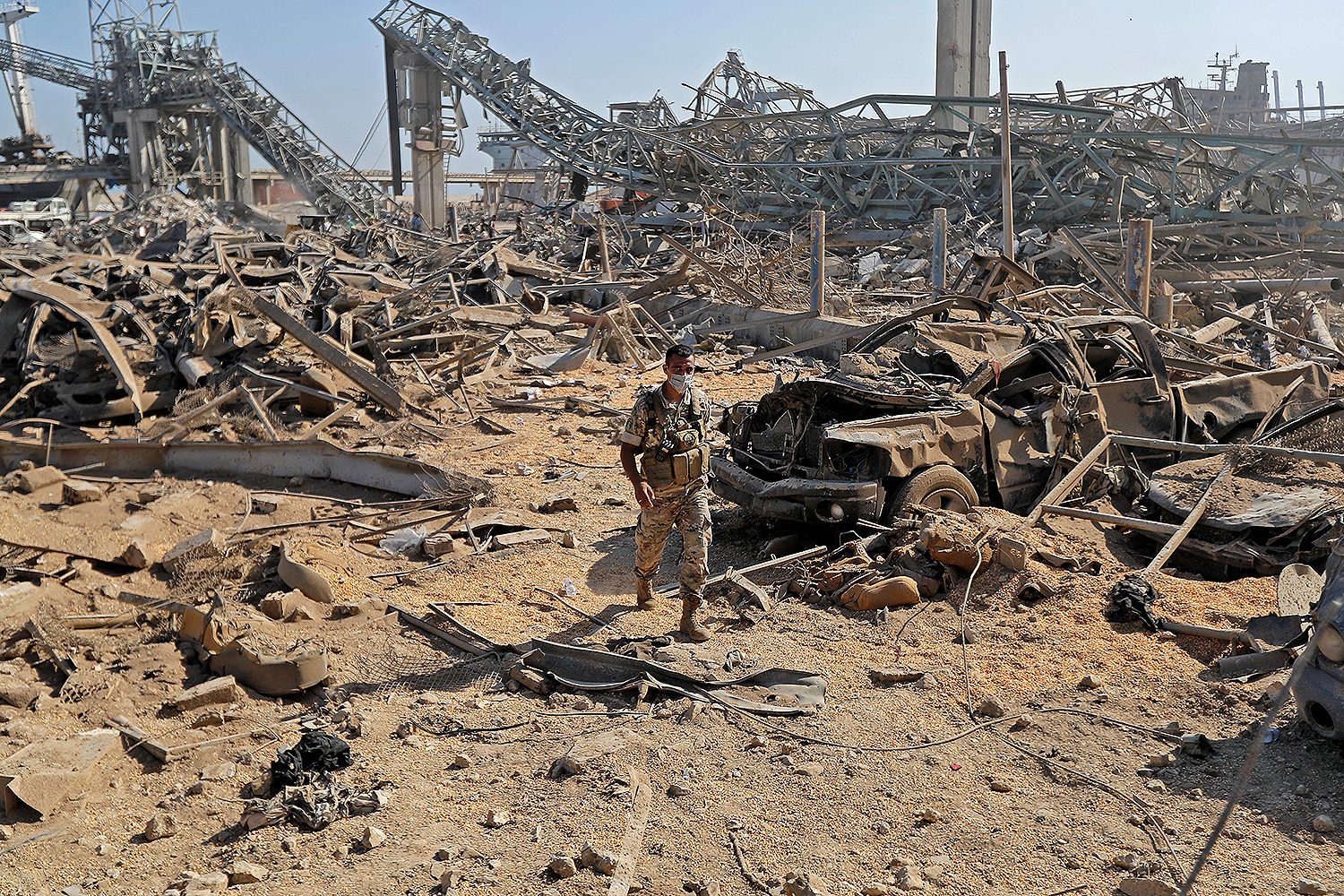 A Lebanese army soldier walks amid debris from the massive blast at the Beirut port on Aug. 7. JOSEPH EID/AFP via Getty Images