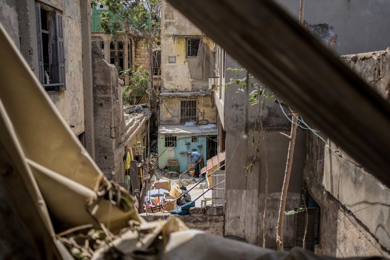 People clear rubble from their historic homes in Beirut's Karantina neighborhood near the port on Aug. 21.