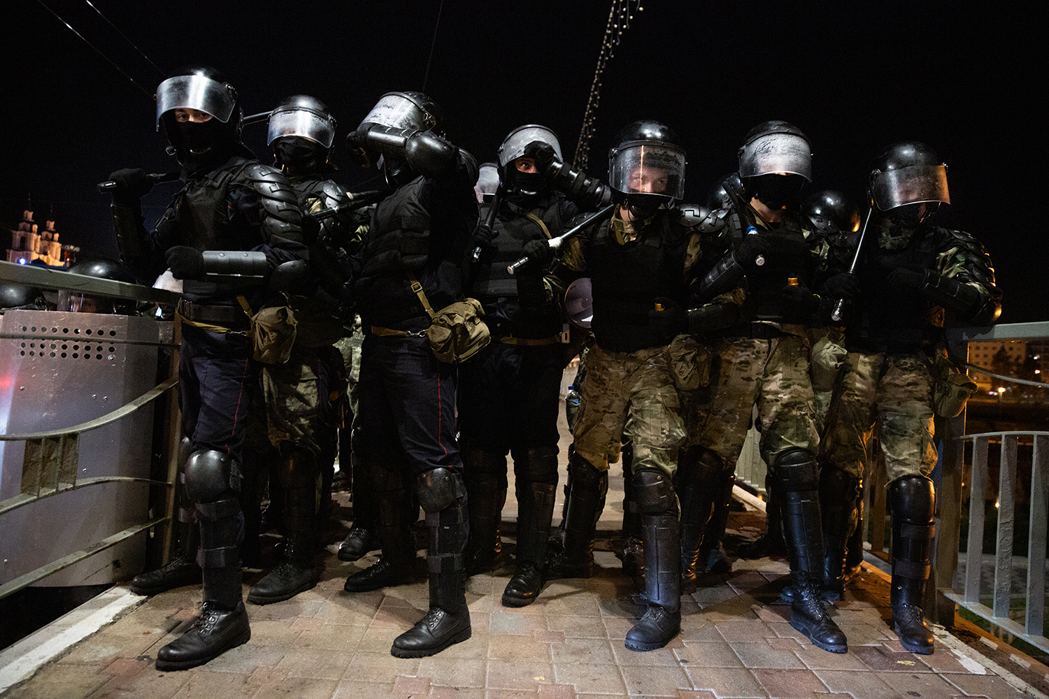 Riot police brace for impact as they square off with protesters in Minsk on Aug. 9.