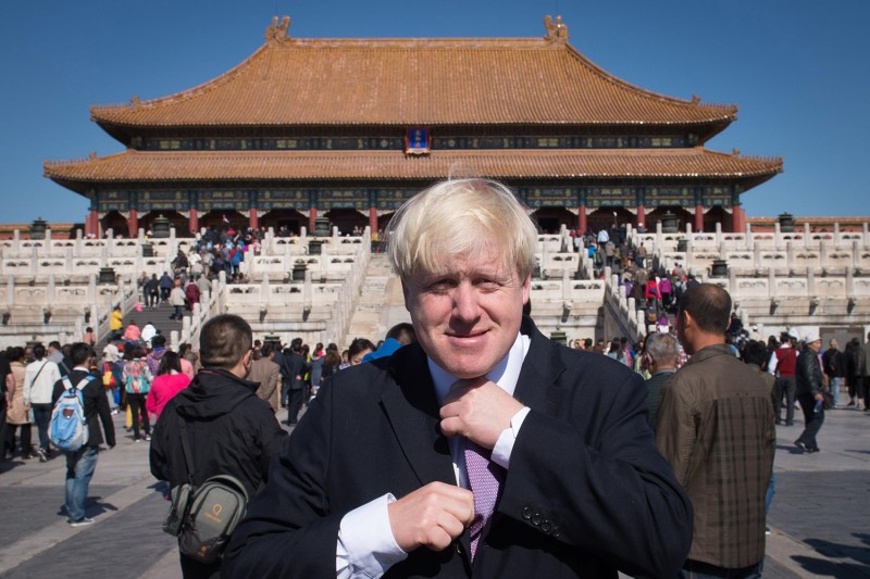 Boris Johnson, as mayor of London, meets tourists during an official visit to the Forbidden City in Beijing on Oct. 15, 2013.