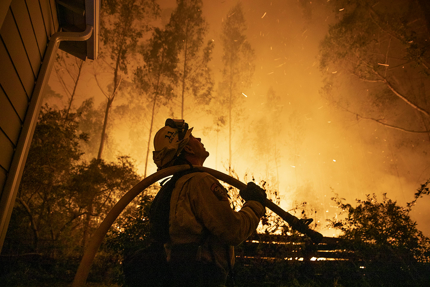 A firefighter attempts to put out a wildfire in San Mateo, California, on Aug. 19. Liu Guanguan/China News Service via Getty Images
