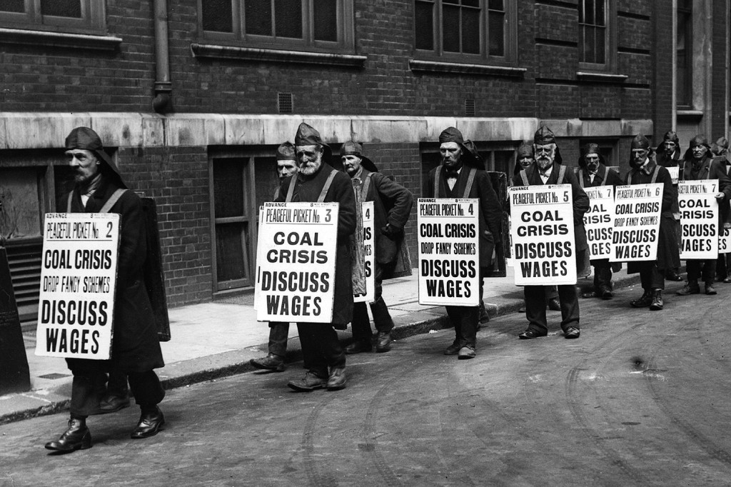 Coal heavers wear sandwich boards to protest against low wages in 1921.