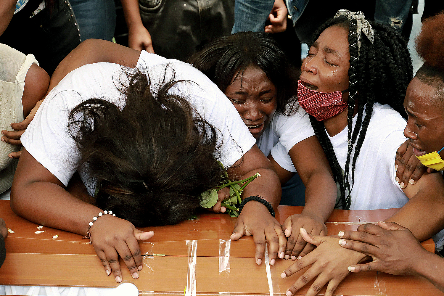 People mourn at the funeral for five teenagers who were found dead in a sugar cane field in Cali, Colombia, on Aug. 14. Juan Bautista Diaz/REUTERS