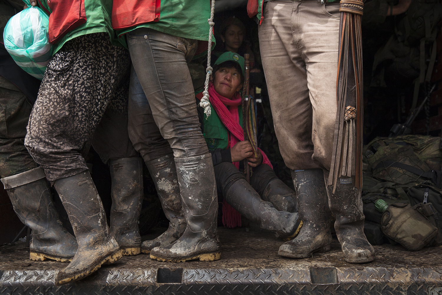 Members of an Indigenous guard in Cauca rest in the back of a truck after days of searching for a woman who was kidnapped by men wearing ELN-identifying armbands on Nov. 18, 2016. In Cauca, Indigenous and ethnic communities have a long history of organizing themselves, even acting as unarmed guardians of their own territories.