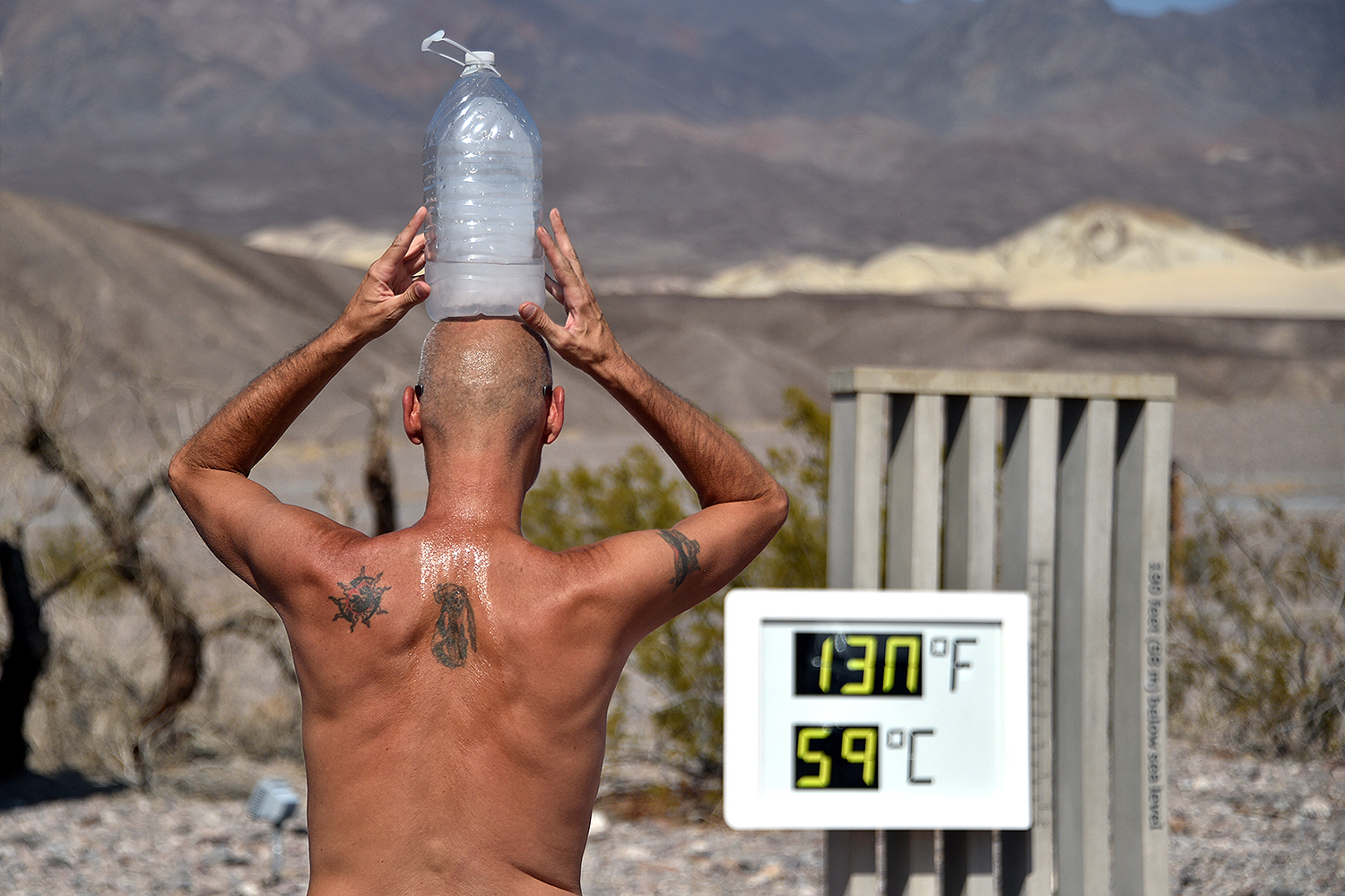 Steve Krofchik of Las Vegas keeps cool with a bottle of ice on his head as the thermometer reads 130 degrees Fahrenheit at the Furnace Creek Visitors Center in Death Valley, California, on Aug. 17. David Becker/REUTERS