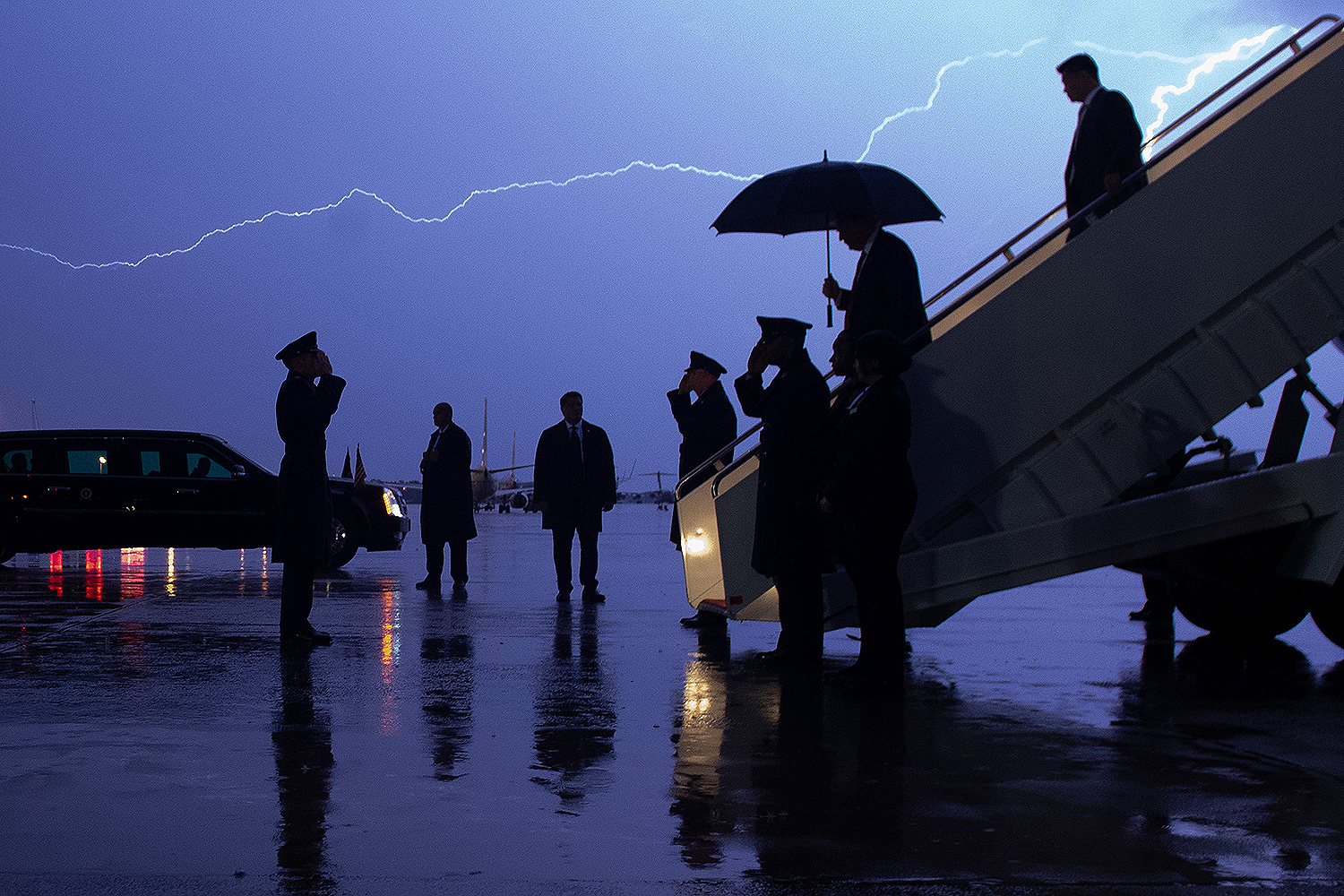 U.S. President Donald Trump disembarks from Air Force One as lightning splits the sky during a storm at Joint Base Andrews in Maryland on Aug. 28. SAUL LOEB/AFP via Getty Images
