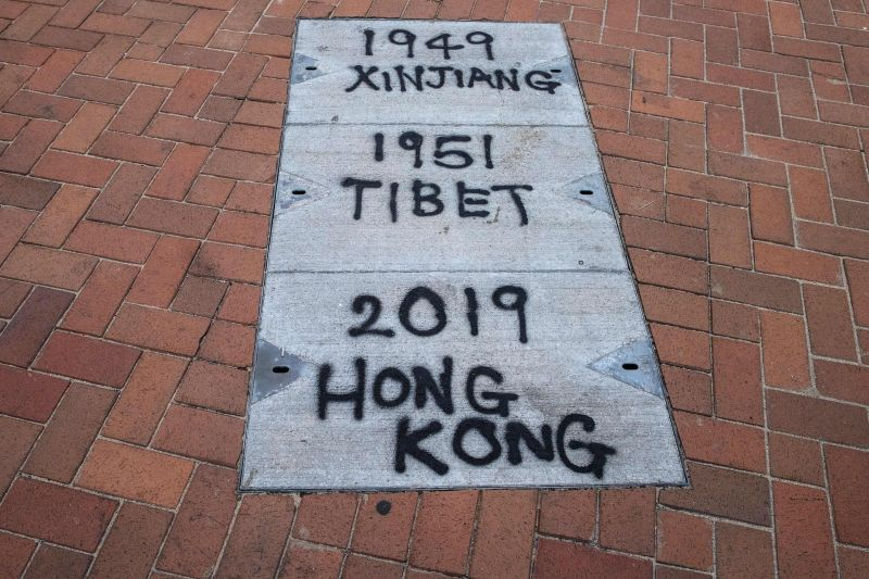 Graffiti relating to Xinjiang and Tibet is seen on the pavement during a rally in Hong Kong to show support for the Uighur minority in China on Dec. 22, 2019.