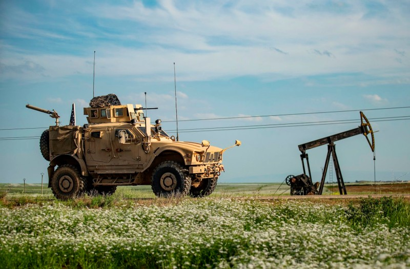 A US military vehicle patrols the oil fields in the town of Qahtaniyah in Syria's northeastern Hasakeh province near the Turkish border, on May 8.
