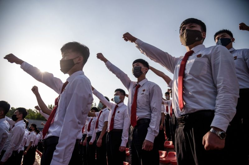 Young people attend a mass gathering denouncing defectors at the Pyongyang Youth Park Open-Air Theater in Pyongyang on June 6.