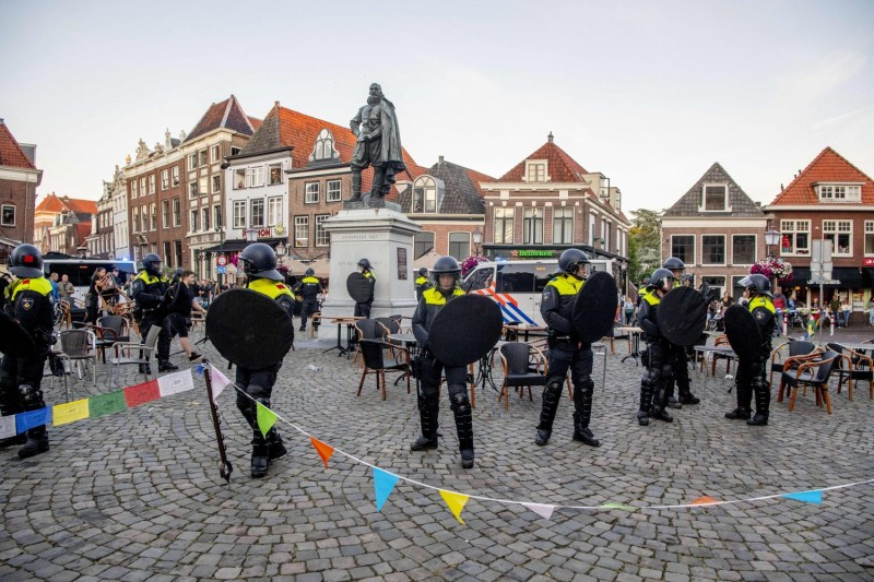 Police stands guard around the statue of Jan Pieterszoon Coen in Hoorn, the Netherlands, on June 19.