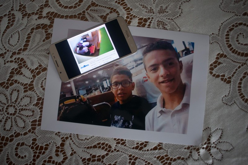 This photo from June 19 shows an image of Iliass Tahiri (left) and his brother and a video still capturing the death of Iliass. Iliass Tahiri, 18, died on July 1, 2019, at the Tierras de Oria detention center in southern Almeria province, Spain.