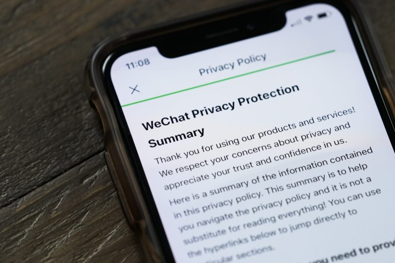 In this photo illustration, the WeChat privacy policy is displayed on an iPhone in Washington on Aug. 7.