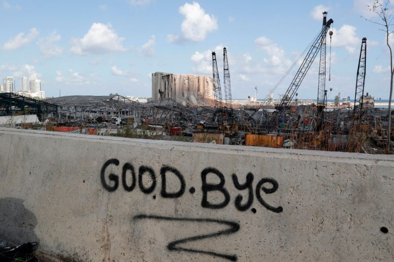 A picture taken on Aug. 9 shows graffiti on the wall of a bridge overlooking the port of Beirut, the site of the explosion which killed at least 154 people and devastated swathes of the capital.