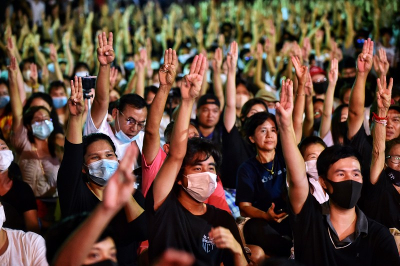 Protesters flash the Hunger Games salute during a pro-democracy rally at Thammasat University in Pathum Thani, north of Bangkok, on August 10.