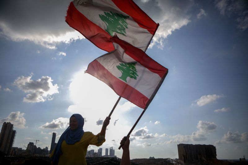 Lebanese women wave the national flag