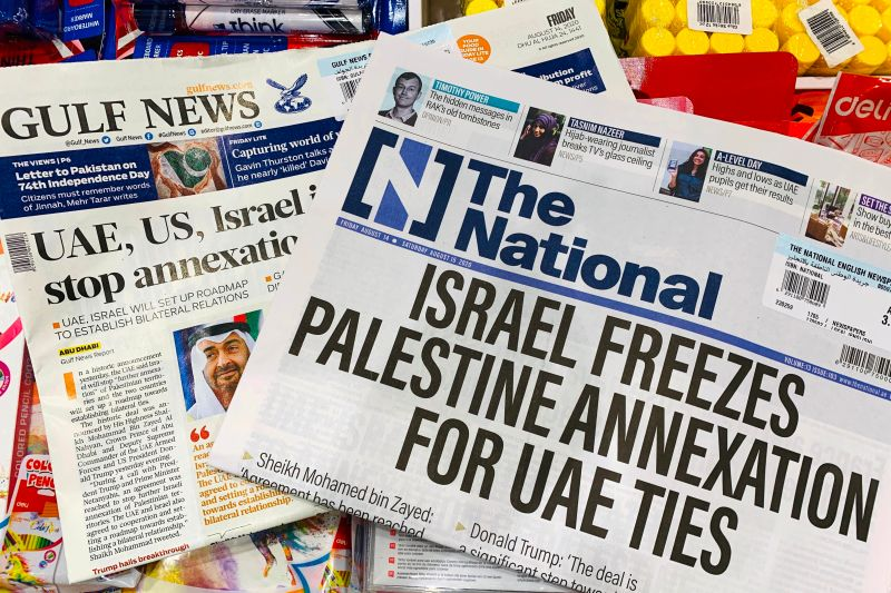 Headlines of the UAE-based The National and Gulf News newspapers reflect the agreement between the UAE and Israel to normalize relations, in Dubai on Aug. 14.