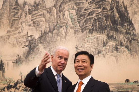 U.S. Vice President Joe Biden (L), chats with his Chinese counterpart Li Yuanchao