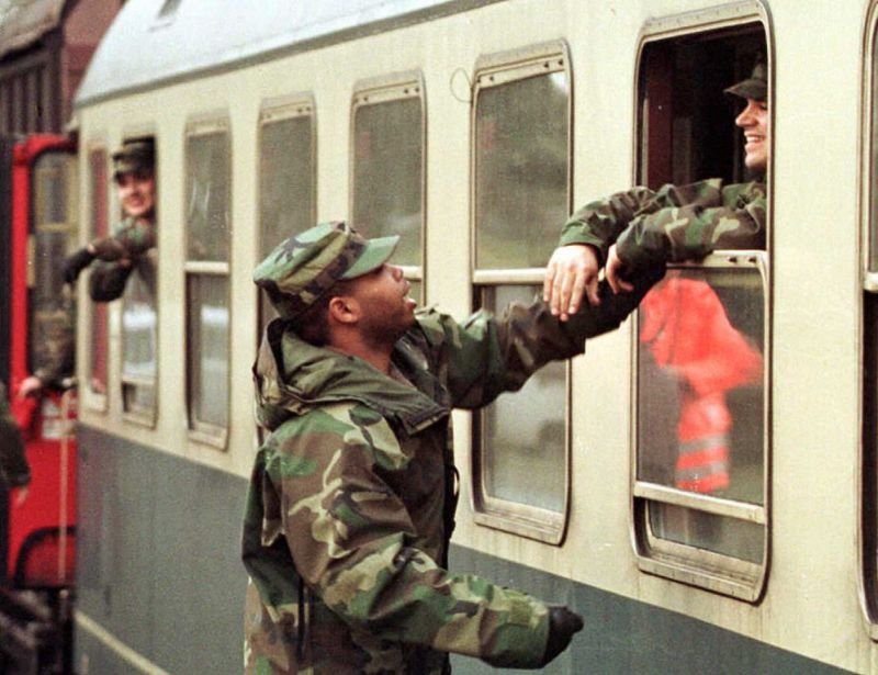 A U.S. serviceman bids farewell to his friend prior to the departure of a detachment of U.S. military police by train from the Coleman Barracks in Mannheim, Germany to Bosnia via Hungary in 1995.