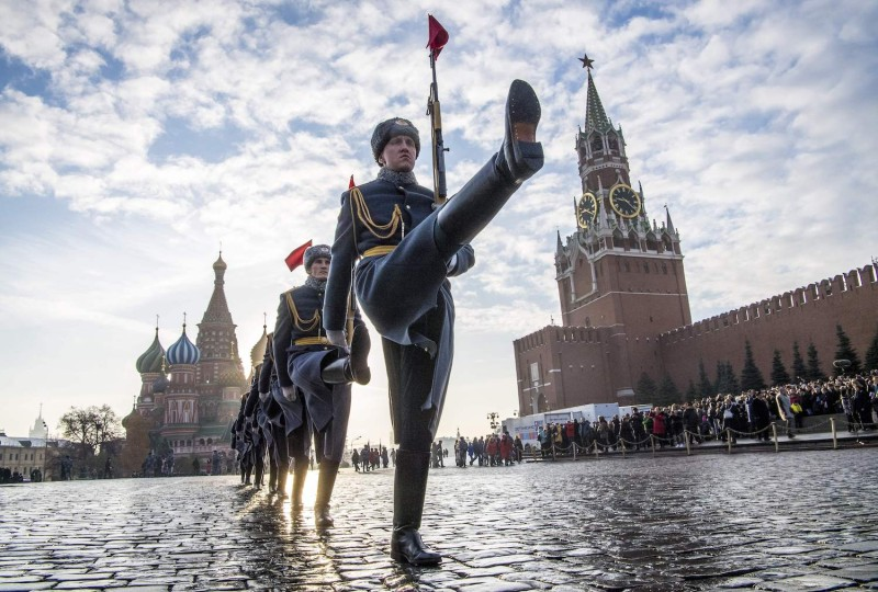 Russian honor guards march during a military parade at Red Square in Moscow on Nov. 7, 2018.