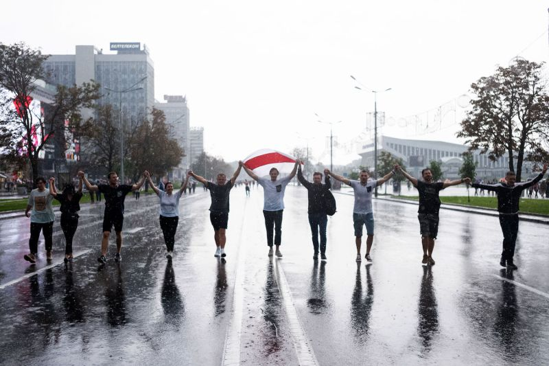 People take part in an anti-government rally in the rain in Minsk, Belarus, on Aug. 30.