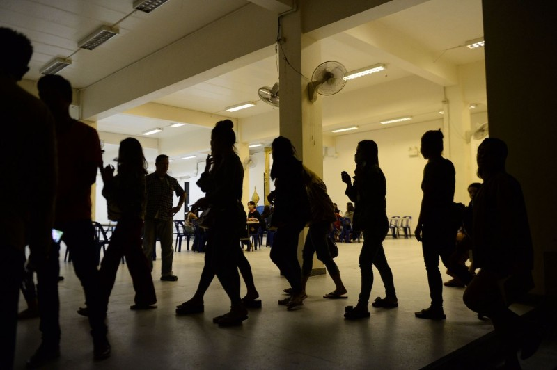 A group of foreign women rounded up by police from karaoke bars in Thailand's southern province of Narathiwat are taken to city hall during a campaign against human trafficking on Nov. 9, 2018.