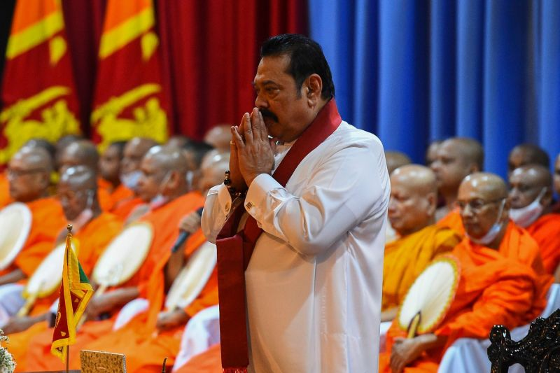 Mahinda Rajapaksa prays during a ceremony before formally assuming prime ministerial duties in Colombo, Sri Lanka, on Aug. 11.