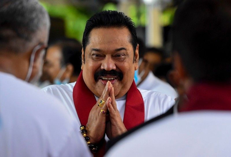 Sri Lanka Prime Minister Mahinda Rajapaksa arrives at his swearing-in ceremony outside Colombo on Aug. 9.