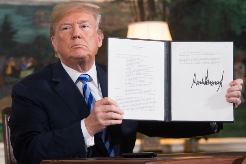 U.S. President Donald Trump signs a document reinstating sanctions against Iran after announcing the U.S. withdrawal from the Iran nuclear deal at the White House in Washington on May 8, 2018.
