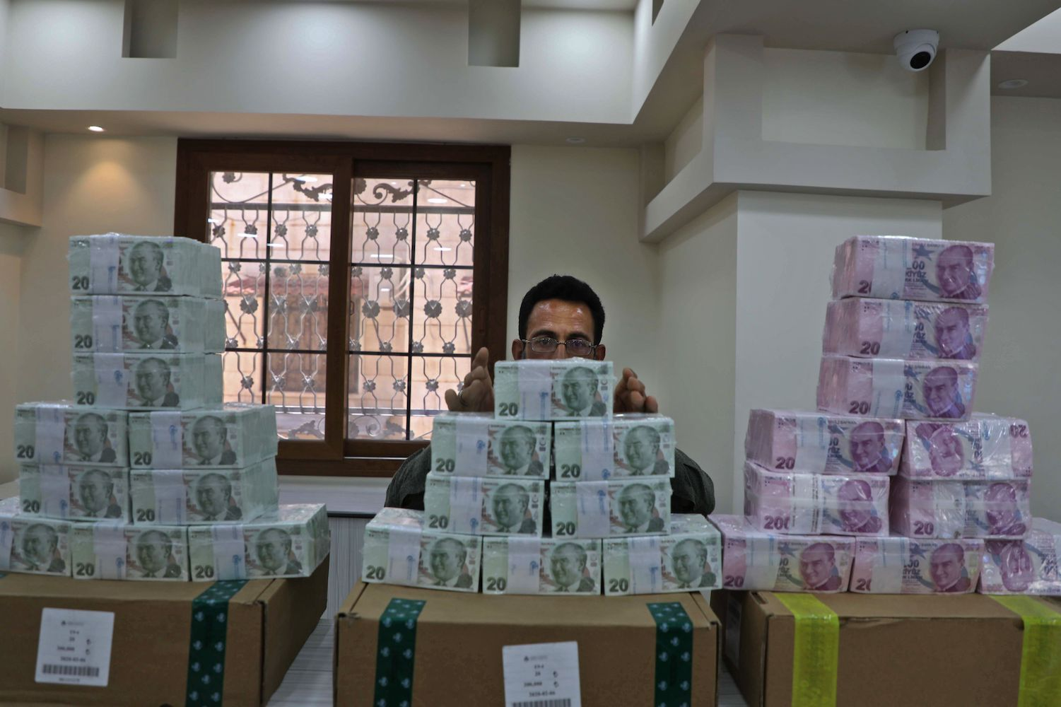 An employee sorts Turkish lira banknotes at a bank in the town of Sarmada in Syria's northwestern Idlib province on June 14.
