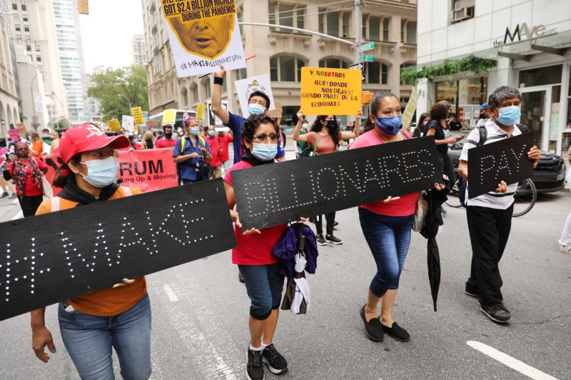 """People participate in a """"March on Billionaires"""" event in New York City on July 17."""