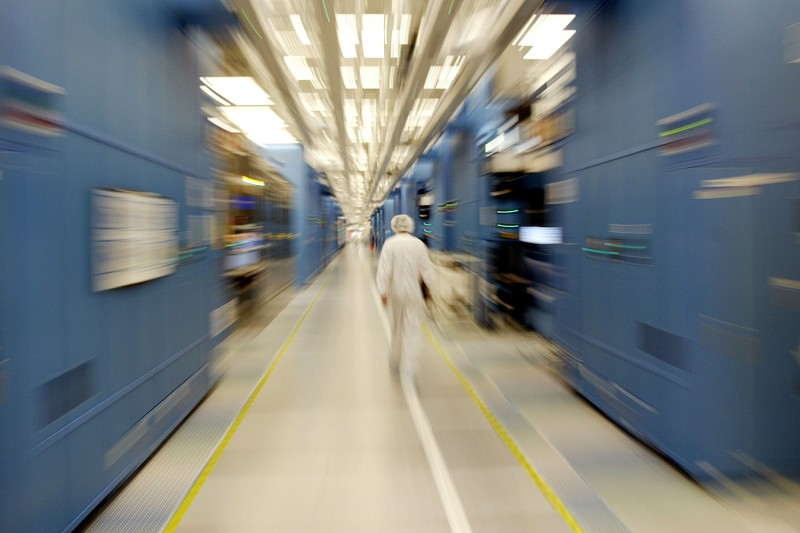 An IBM worker walks inside the company's 12-inch wafer chip fabricating plant in Fishkill, New York, on July 20, 2004. Mario Tama/Getty Images
