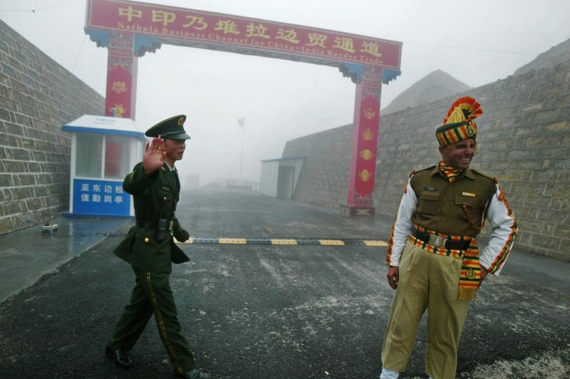 A Chinese soldier and an Indian solider stand guard at the Nathu La border crossing between India and China on July 10, 2008.