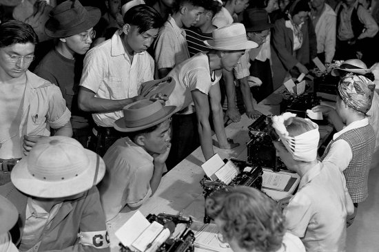 Japanese Americans deal with paperwork at an internment camp in this undated photograph.