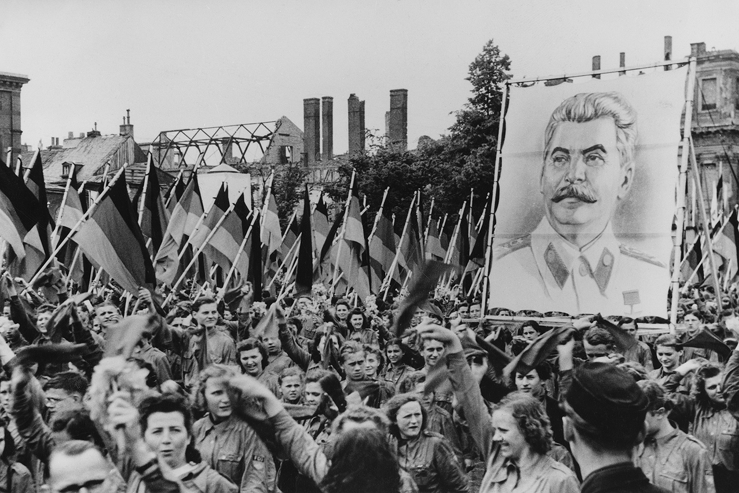 Young people carry portraits of Communist leader Joseph Stalin during a Soviet-sponsored youth rally in Berlin.