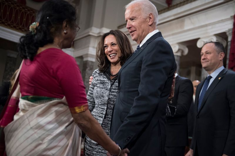 Then Vice President Joe Biden talks with Sen. Kamala Harris and her aunt, Sarala Gopalan, during a swearing-in ceremony at the Capitol on Jan. 3, 2016.