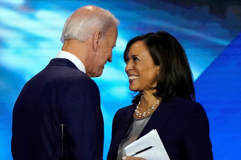 Former Vice President Joe Biden talks with Senator Kamala Harris after the conclusion of the 2020 Democratic U.S. presidential debate in Houston, Texas, U.S., on Sept. 12, 2019.
