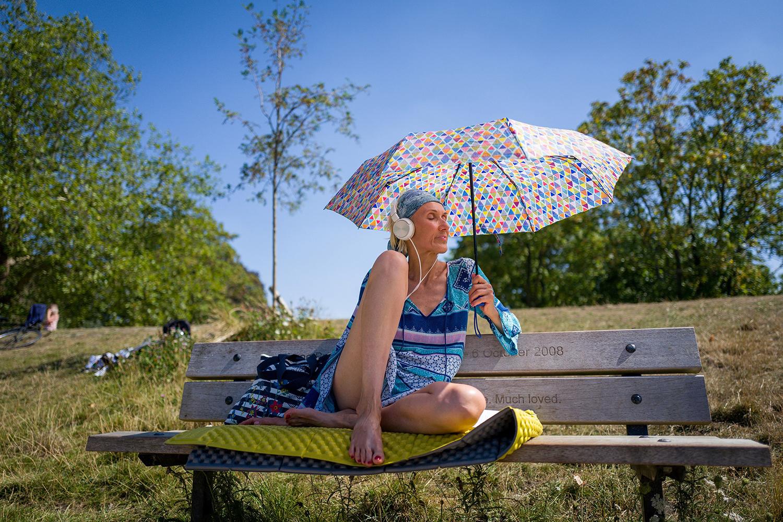 A woman sunbathes at Hampstead Heath ponds in London as the temperature soars Aug. 7. TOLGA AKMEN/Tolga Akmen/AFP via Getty Images