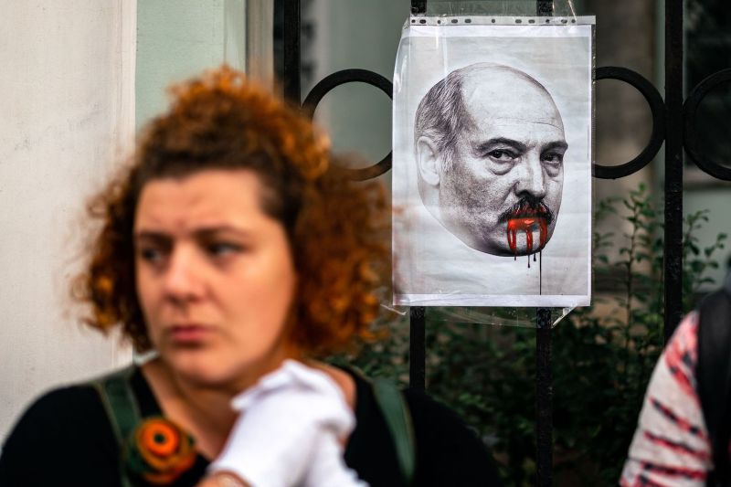 Demonstrators protest against the results of the recent Belarusian presidential election outside the Belarusian Embassy in Moscow on Aug. 12.