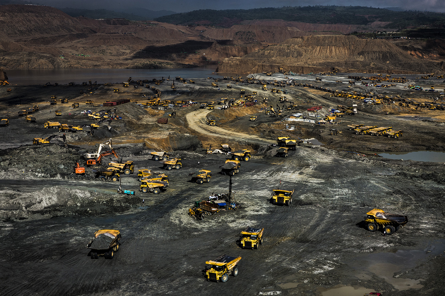 Company trucks dot a massive government-licensed jade mining site in Hpakant on Oct. 16, 2018.