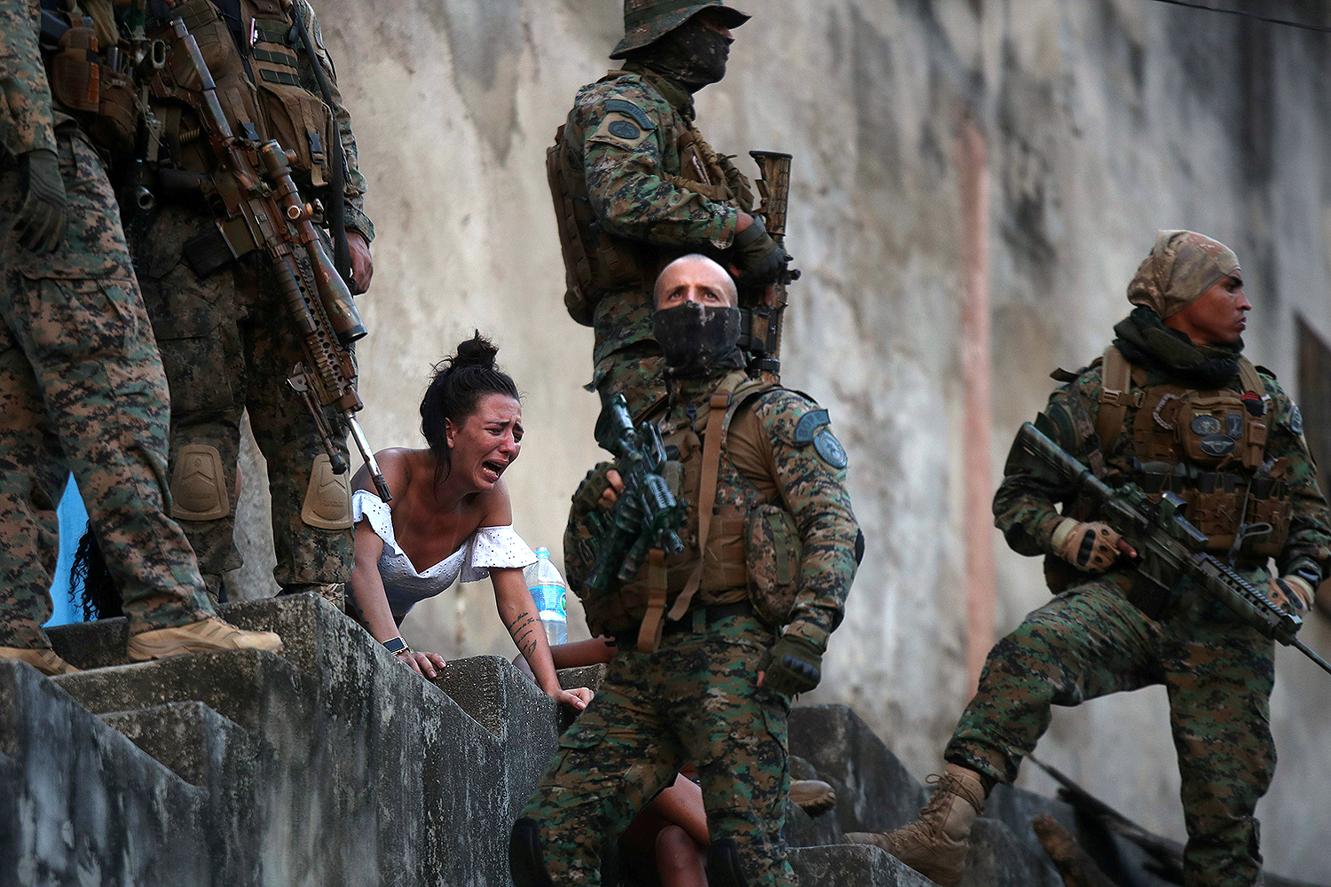 A woman reacts next to the body of a person who was shot during a police operation after heavy confrontations between drug gangs in Rio de Janeiro on Aug. 27. Ricardo Moraes/REUTERS