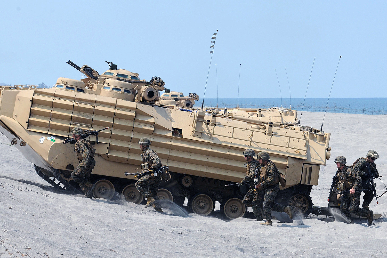 U.S. Marines exit an amphibious assault vehicle.