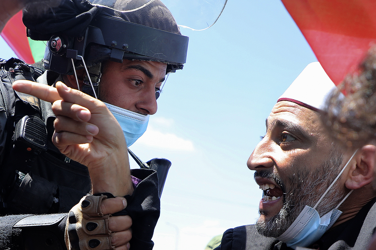 A Palestinian demonstrator argues with Israeli security forces in the West Bank village of Haris, southwest of Nablus, on Aug. 21 during a rally to protest against Israel's plan to annex parts of the occupied West Bank. JAAFAR ASHTIYEH/AFP via Getty Images