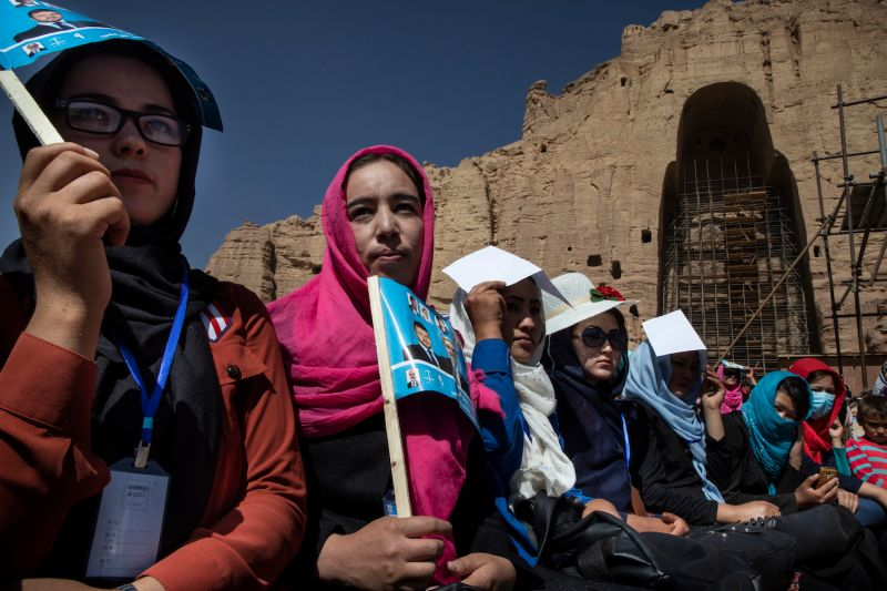 Afghan women listen to speeches during the final campaign rally for Abdullah Abdullah.