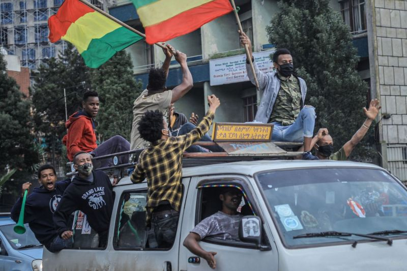 Ethiopian citizens celebrate the successful filling of the Grand Ethiopian Renaissance Dam (GERD) as the dam's first two turbines' electricity production is tested, in Addis Ababa, Ethiopia, on August 2, 2020.