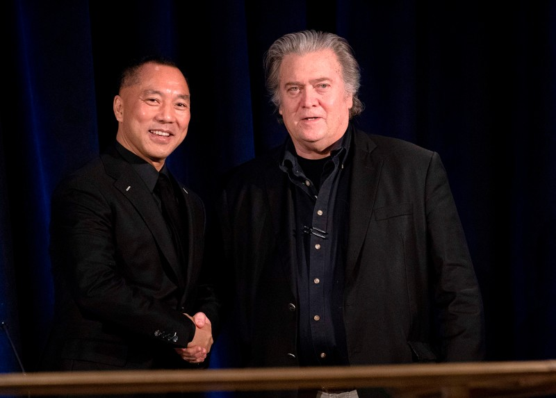 Former White House Chief Strategist Steve Bannon greets the fugitive Chinese billionaire Guo Wengui before introducing him at a news conference in New York on Nov. 20, 2018.
