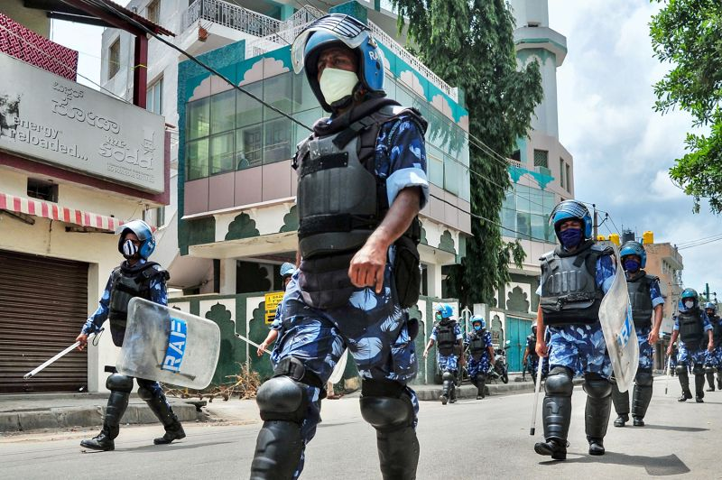 India's Rapid Action Force personnel patrol a street in Bengaluru on Aug. 13, after a derogatory Facebook post about the prophet Mohammed sparked riots.