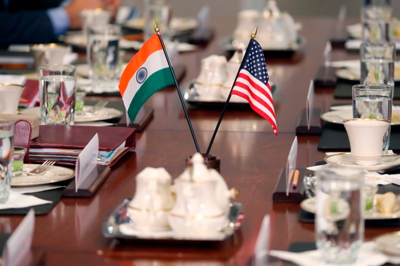 The flags of the United States and India adorn a conference table during a meeting between representatives of the two countries.