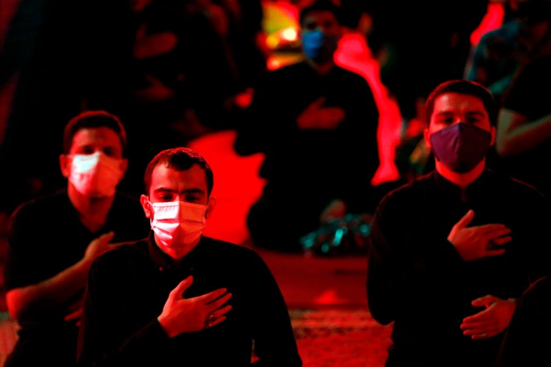 Iranian Shiite Muslims adhere to social distancing due to the COVID-19 pandemic as they attend a mourning ritual to commemorate the Prophet Muhammad's grandson Imam Hussein during the Islamic month of Muharram in advance of the Ashura religious holiday.